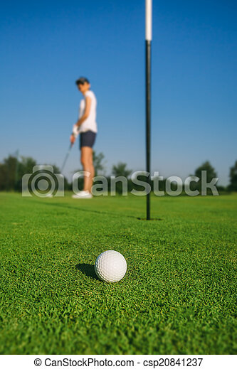 Woman playing golf - csp20841237