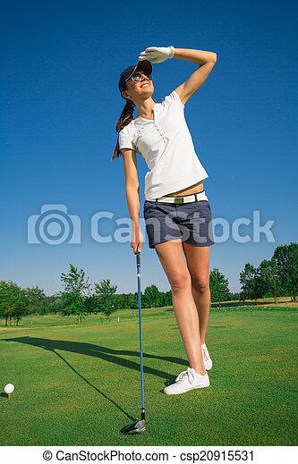 Woman playing golf - csp20915531