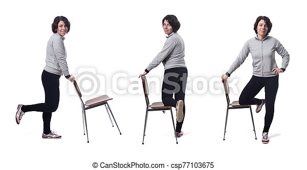 woman playing with a chair in white background - csp77103675