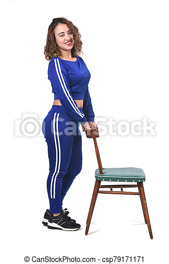 woman playing with a chair in white background - csp79171171