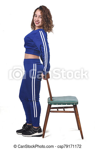 woman playing with a chair in white background - csp79171172