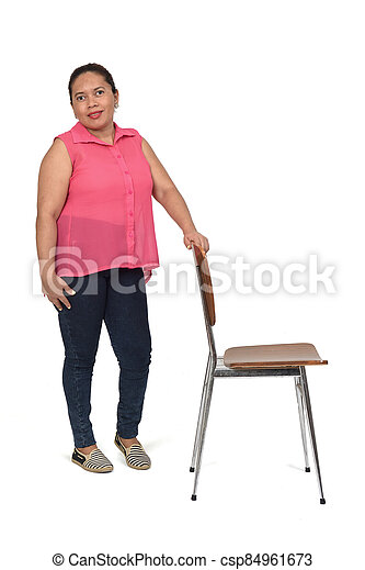 woman playing with a chair in white background, - csp84961673