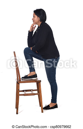 woman playing with a chair in white background,profile hands on chin - csp80979662