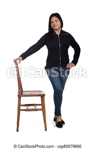 woman playing with a chair in white background, front view, - csp80979666