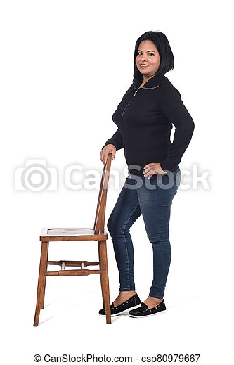 woman playing with a chair in white background - csp80979667