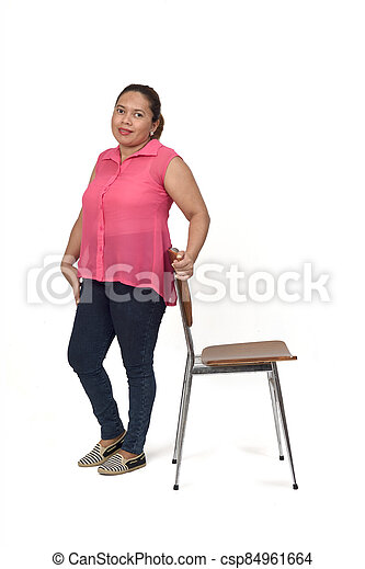 woman playing with a chair in white background, - csp84961664