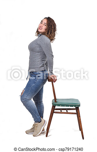 woman playing with a chair in white background - csp79171240