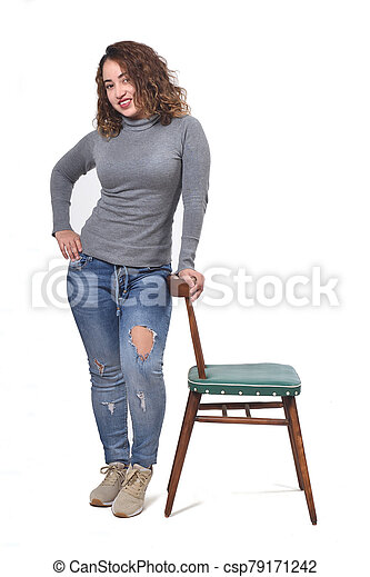 woman playing with a chair in white background - csp79171242