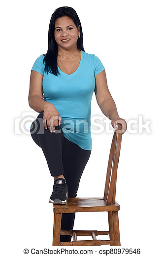 woman playing with a chair in white background - csp80979546