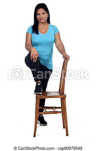 woman playing with a chair in white background - csp80979549