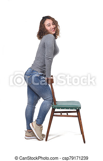woman playing with a chair in white background - csp79171239