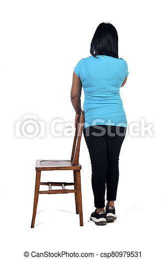woman playing with a chair in white background, rear view - csp80979531