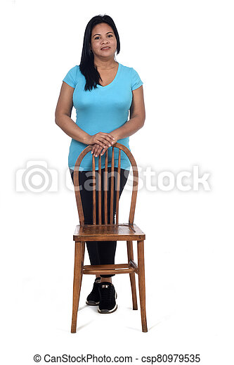 woman playing with a chair in white background - csp80979535