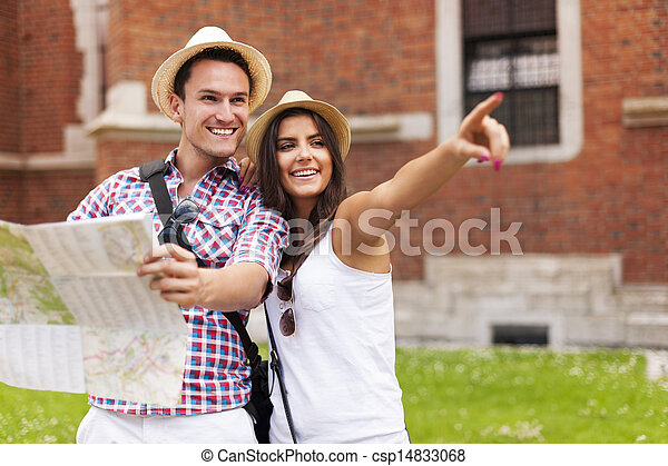 Woman pointing at something to her boyfriend during sightseeing - csp14833068