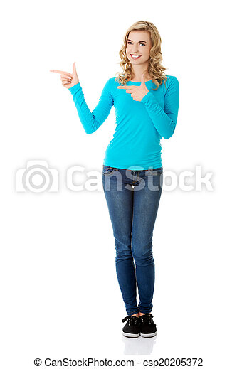 Woman pointing on copy space. - csp20205372