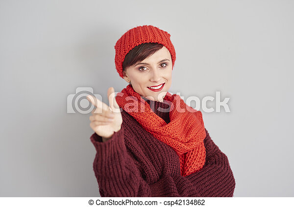 Woman pointing on the copy space - csp42134862