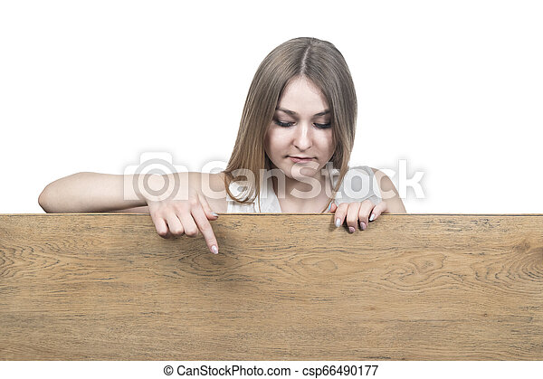 woman points down to a wooden board - csp66490177