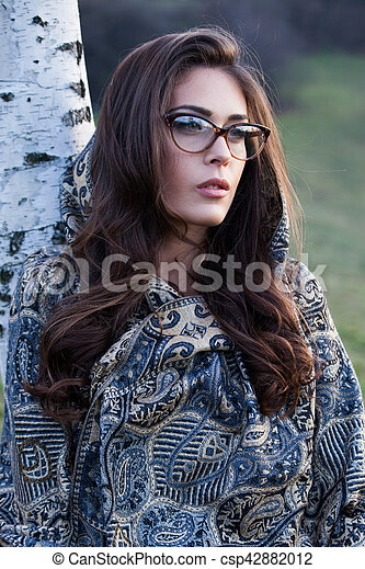 woman portrait with eyeglasses and scarf outdoor - csp42882012