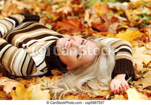 woman portret in autumn leaf - csp5997557