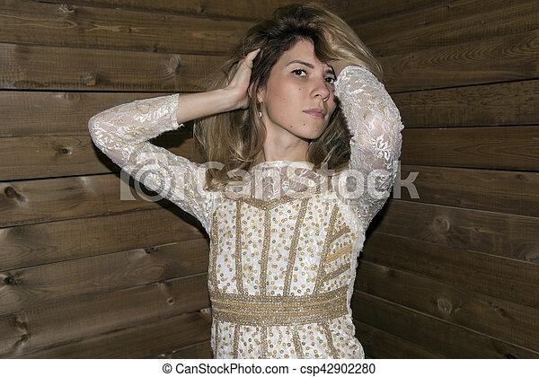 woman pose at wood background - csp42902280