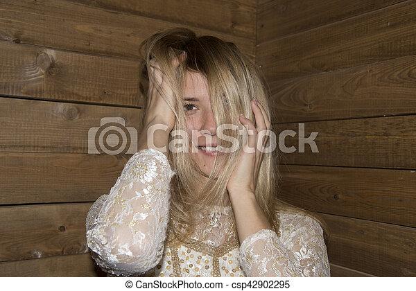 woman pose at wood background - csp42902295