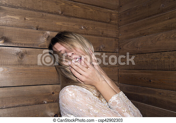 woman pose at wood background - csp42902303