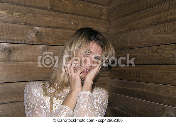 woman pose at wood background - csp42902306