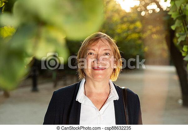 Woman posing in green park - csp88632235