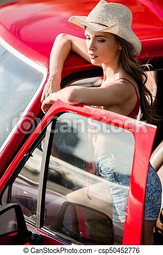 woman posing next to car - csp50452776