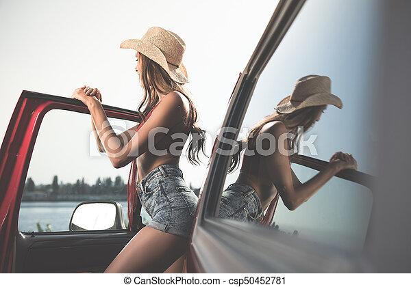 woman posing next to car - csp50452781