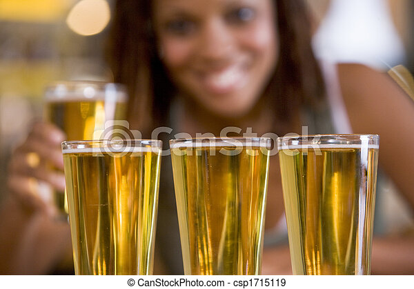Woman posing with several beer glasses - csp1715119