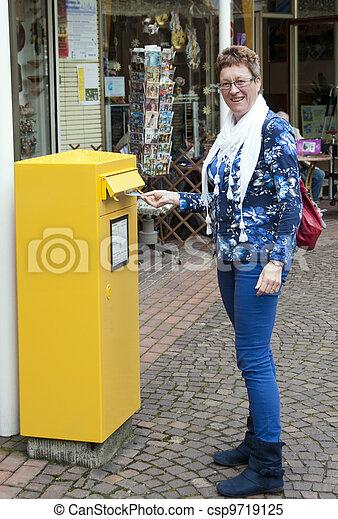 woman posting a post card - csp9719125