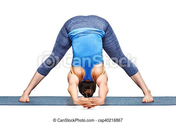 woman practices ashtanga vinyasa yoga asana prasarita