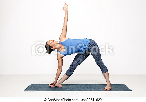 woman practices yoga asana utthita trikonasana beautiful
