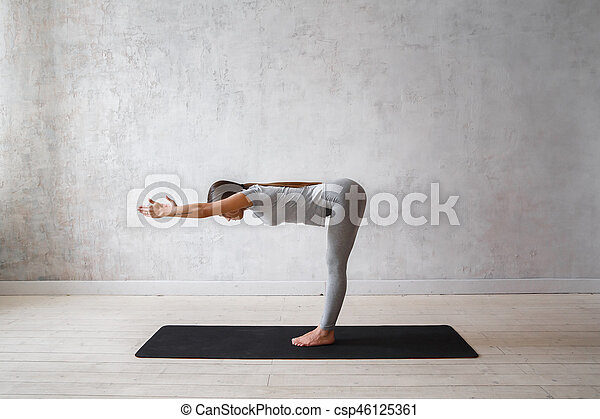 Woman Practicing Advanced Yoga A Series Of Poses