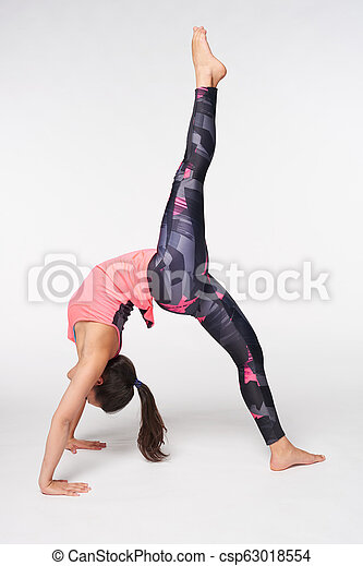 woman practicing onelegged bridge pose over white young