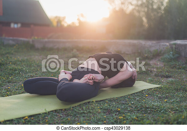 woman practicing outdoors meditating in yoga position