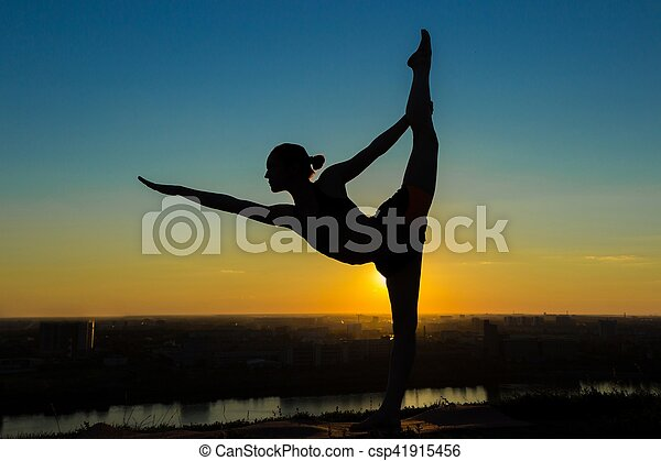 woman practicing yoga  lord of the dance pose silhouette