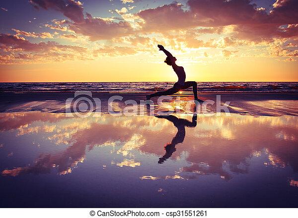 woman practicing yoga  - csp31551261