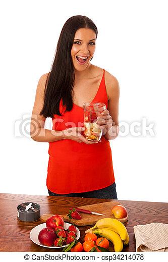 Woman preparing healthy fresh fruit smoothie. - csp34214078