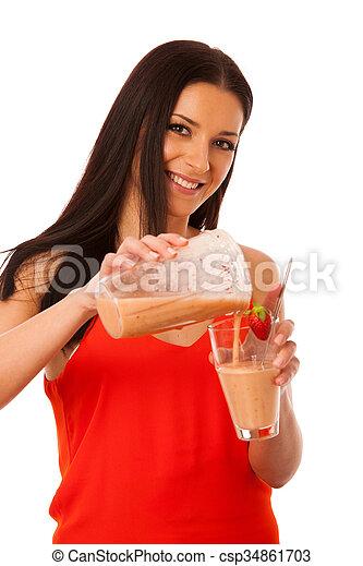 Woman preparing healthy fresh fruit smoothie. - csp34861703