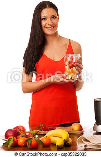 Woman preparing healthy fresh fruit smoothie. - csp35322035