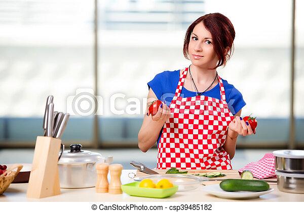 Woman preparing salad in the kitchen - csp39485182