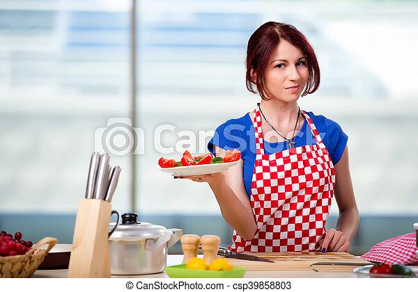 Woman preparing salad in the kitchen - csp39858803