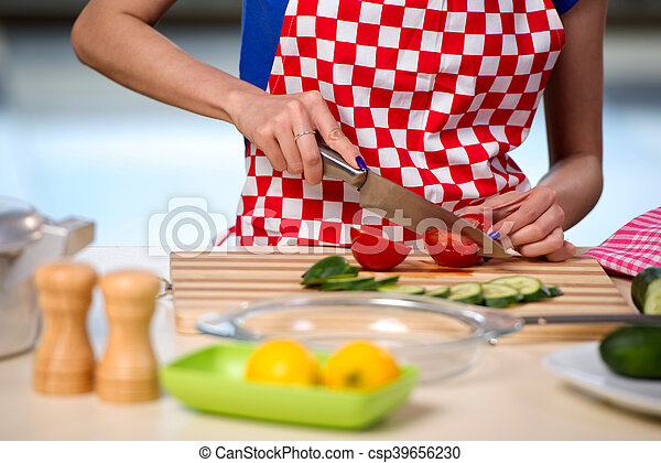 Woman preparing salad in the kitchen - csp39656230