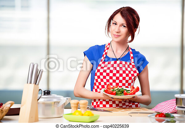 Woman preparing salad in the kitchen - csp40225639