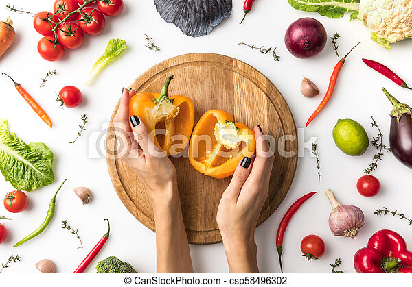 woman preparing yellow bell pepper - csp58496302
