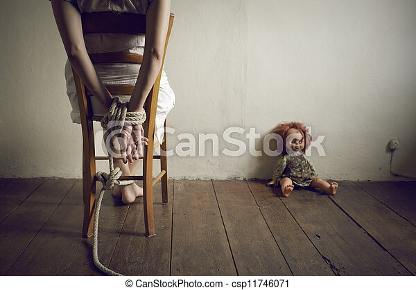 Person Tied To A Chair