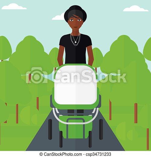 Woman pushing pram. - csp34731233
