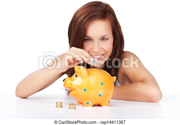 Woman putting coins in her piggy bank - csp14411367